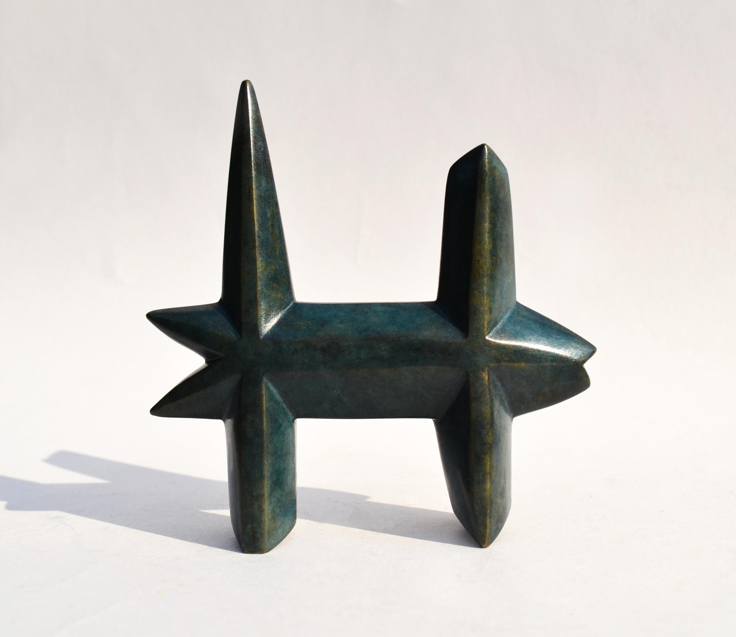 "Dog Fish,  bronze, 3 1/2"" x 3 1/2"" x 3/4"", $375"