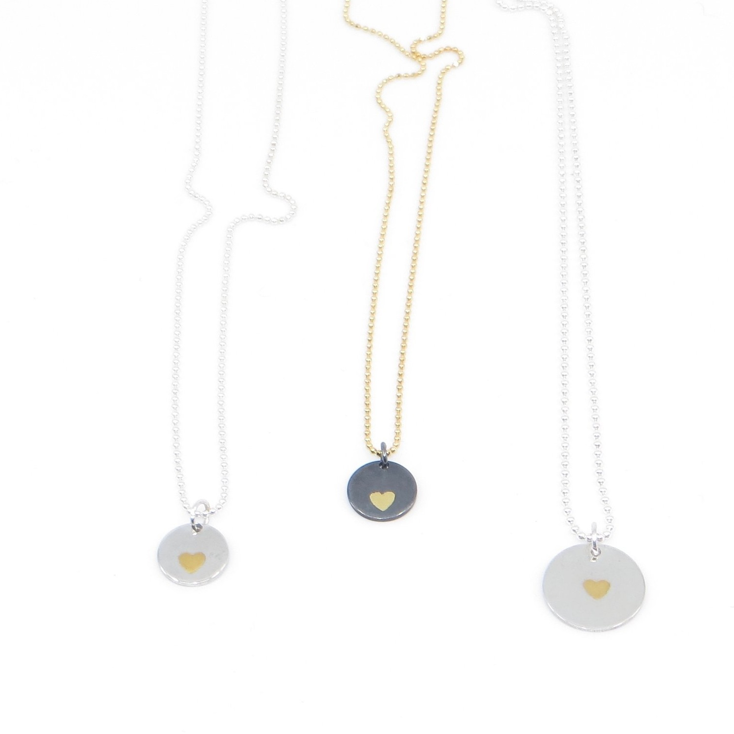 Sweetheart necklaces, keumboo with 24K gold and sterling silver, various sizes, $80 - $90