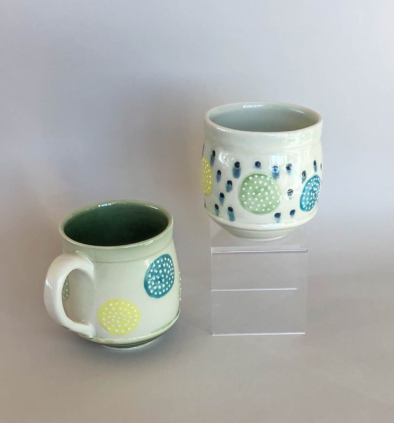 Colorful circles mug and tumbler, wheel thrown porcelain with slip trail design, $42 and $36