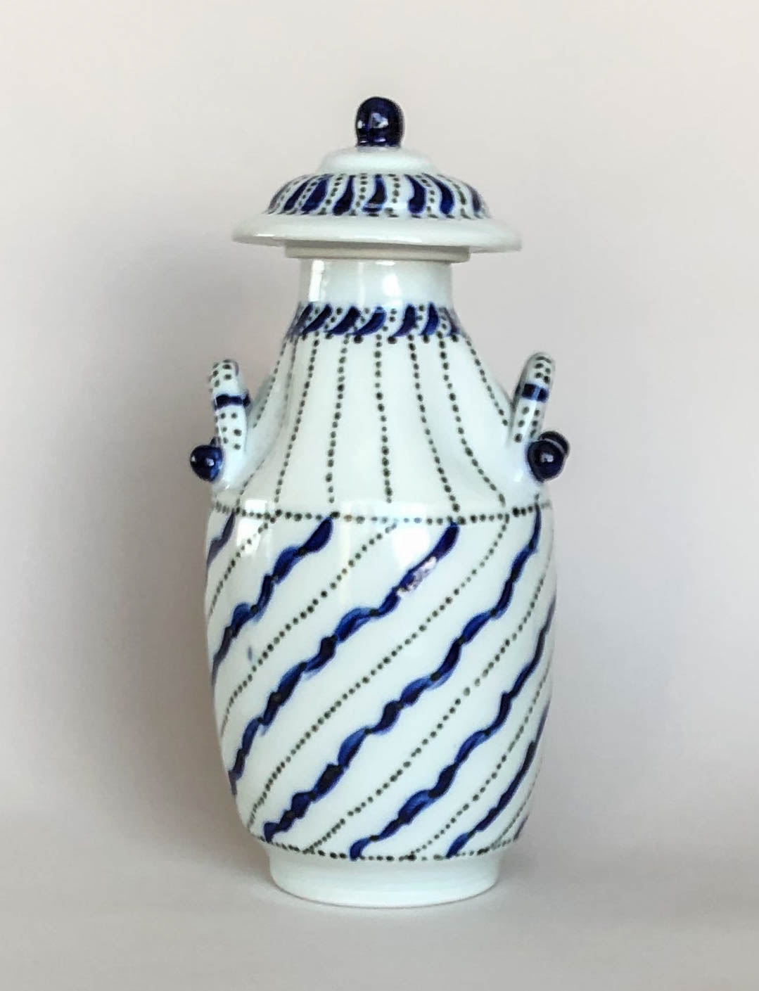 Covered bottle, wheel thrown porcelain with hand painted design, $135