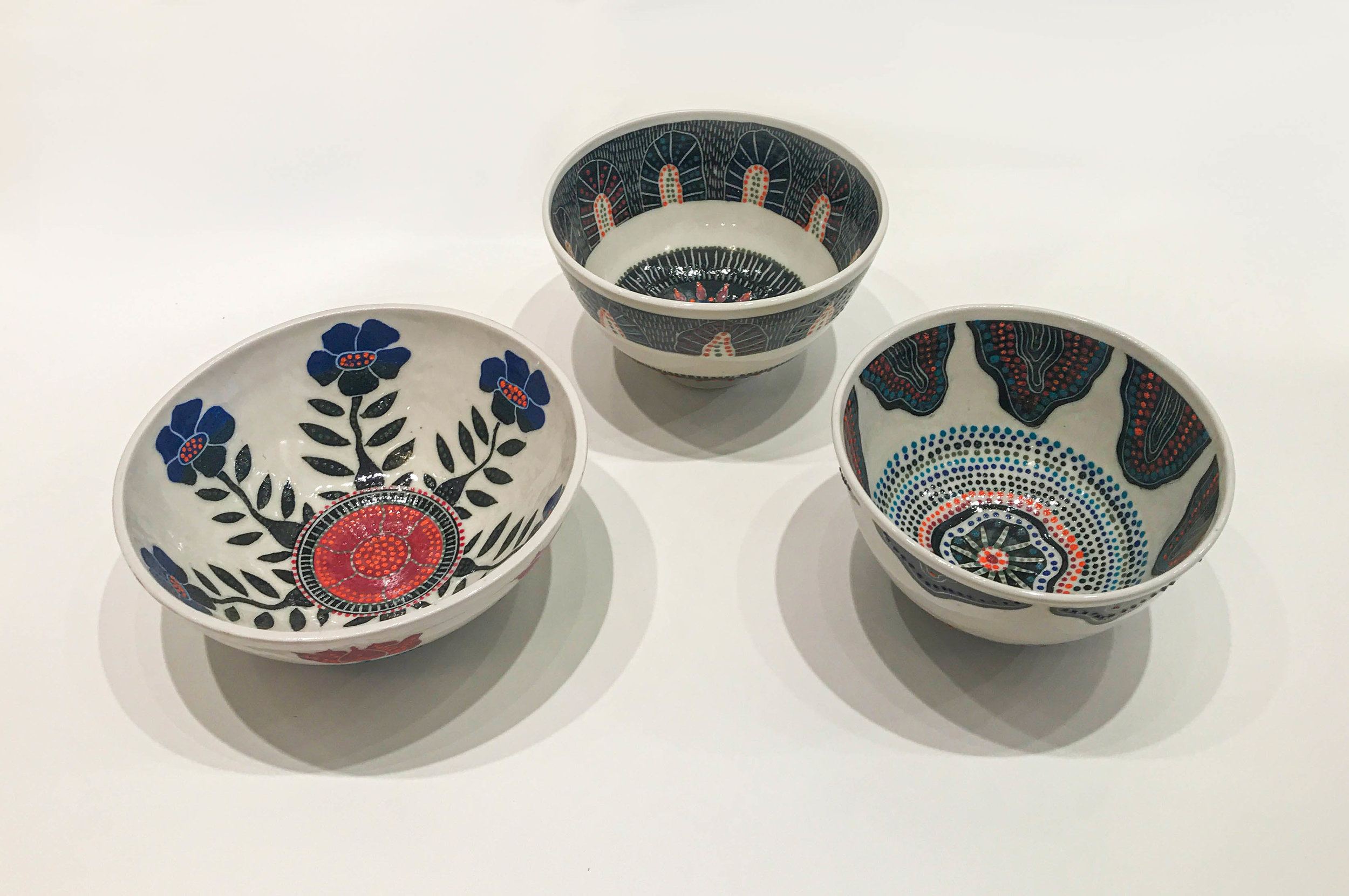 Sgraffito bowls, hand carved slip design on wheel thrown porcelain, $75 - $150