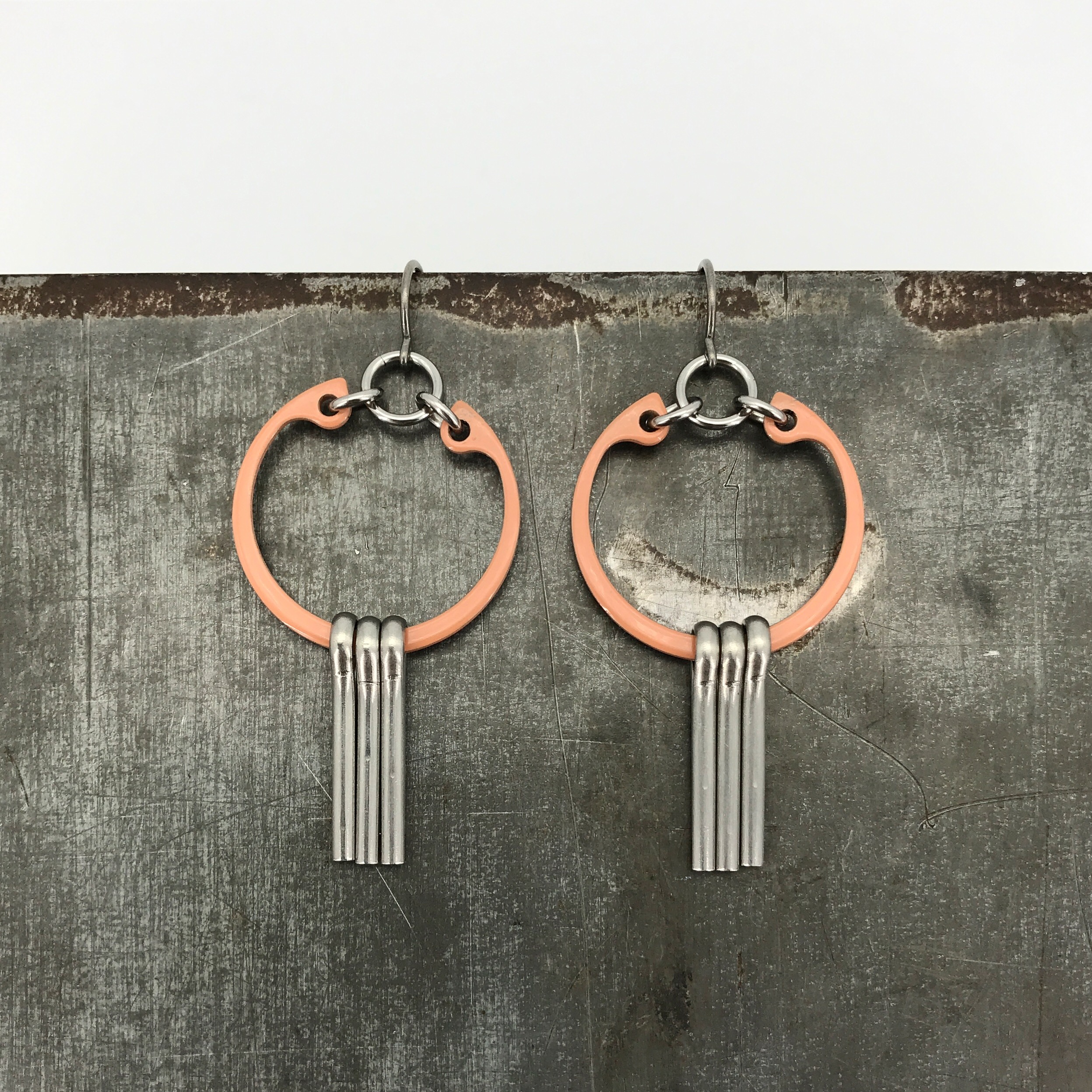 Centro earrings, niobium ear wire, sienna powder coated steel rings, and stainless steel pins, $50