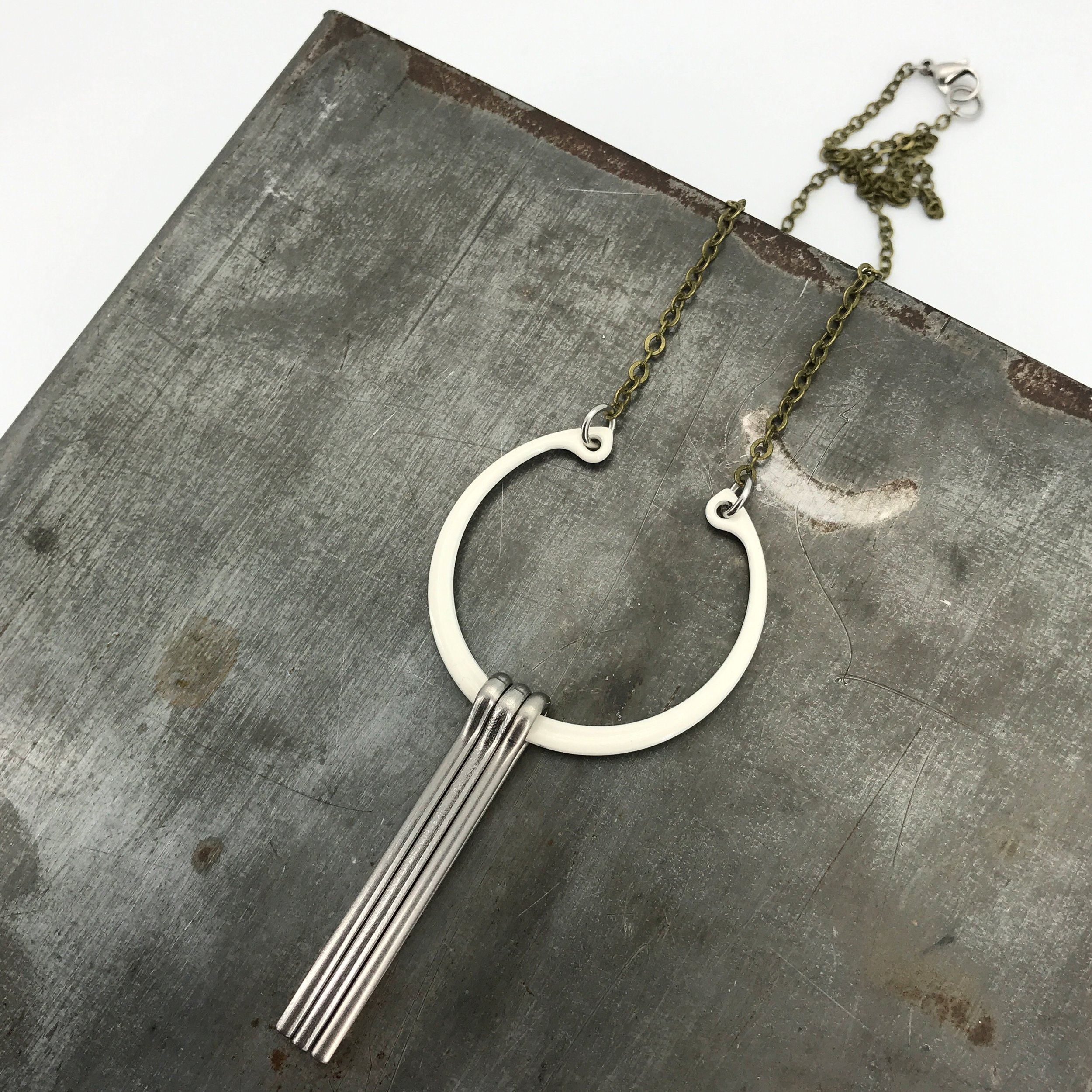 Centro necklace, cream powder coated steel ring with stainless steel pins, oxidized brass chain, $65