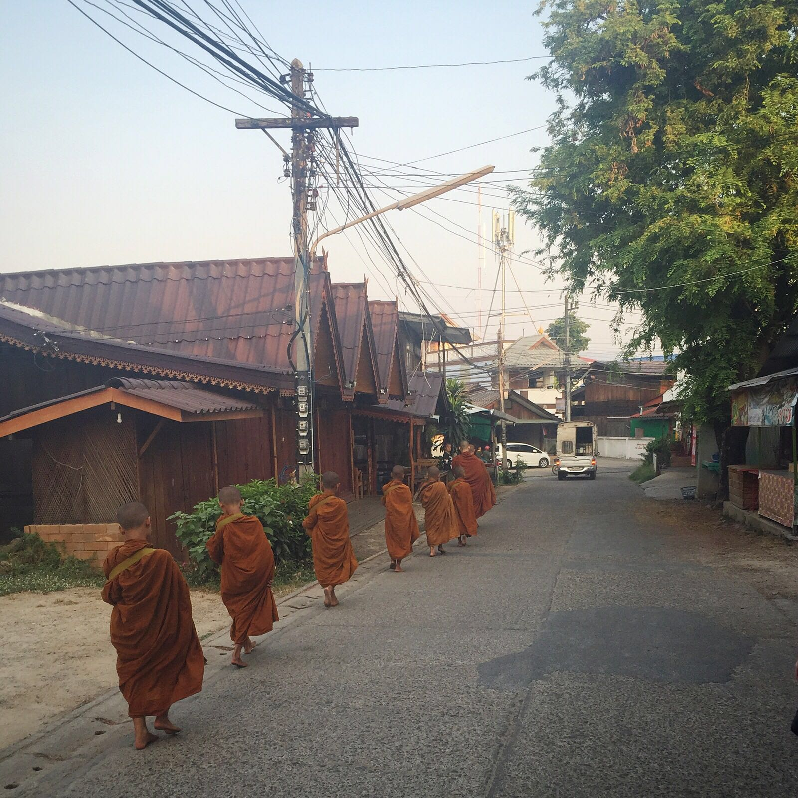 Monks waking through the community getting their daily breakfast from shop owners.