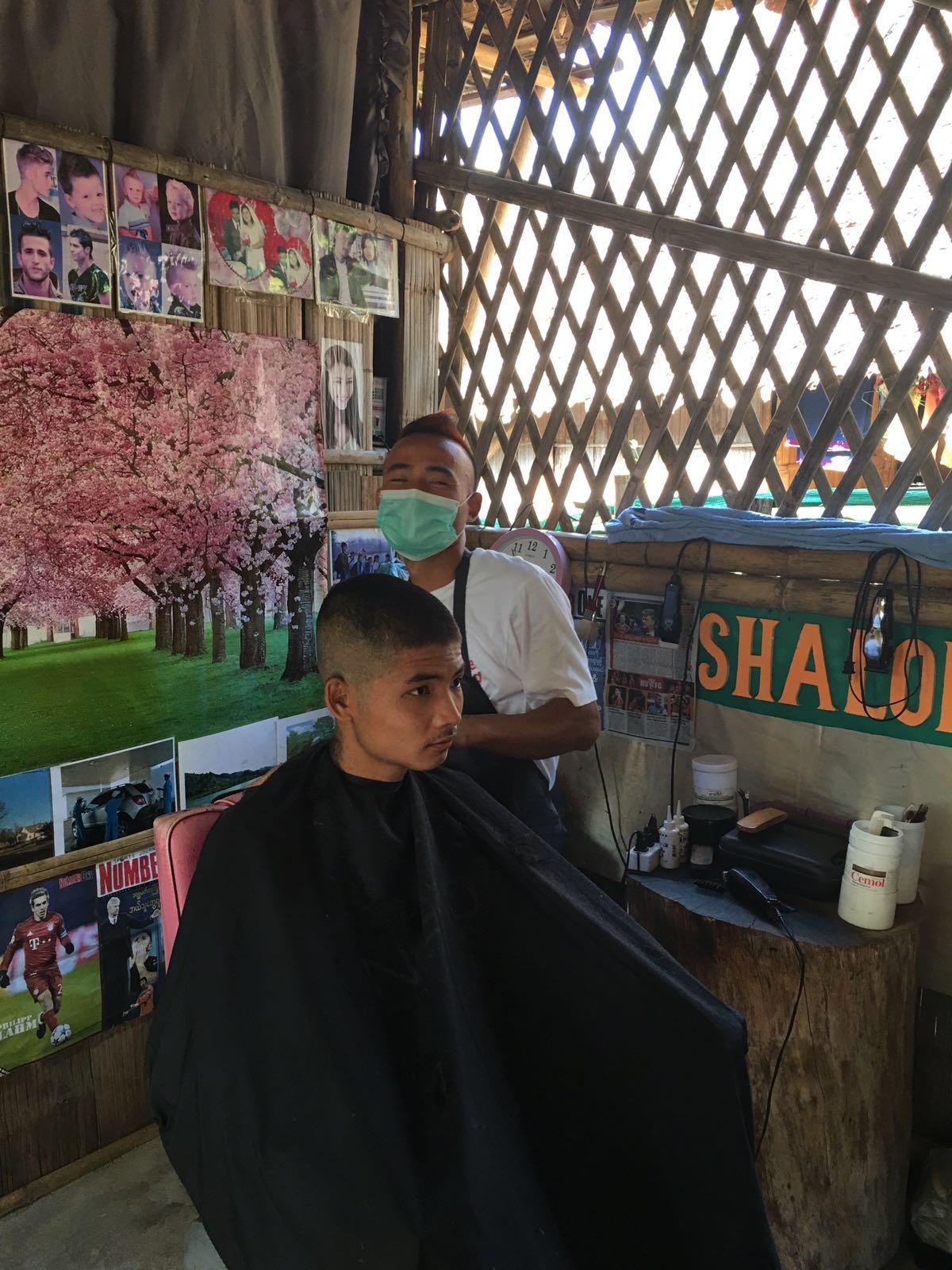 Paul in his salon in Nu Po Refugee Camp