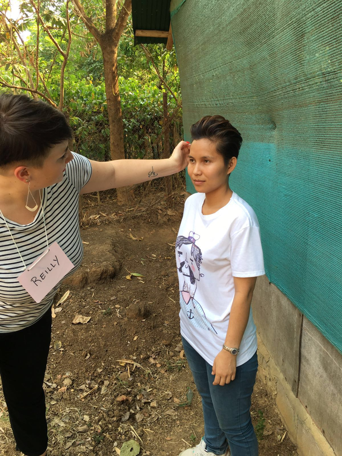 """Reilly from HAUS Salon South Minneapolis touches up Phadkaew for her """"after"""" photo."""