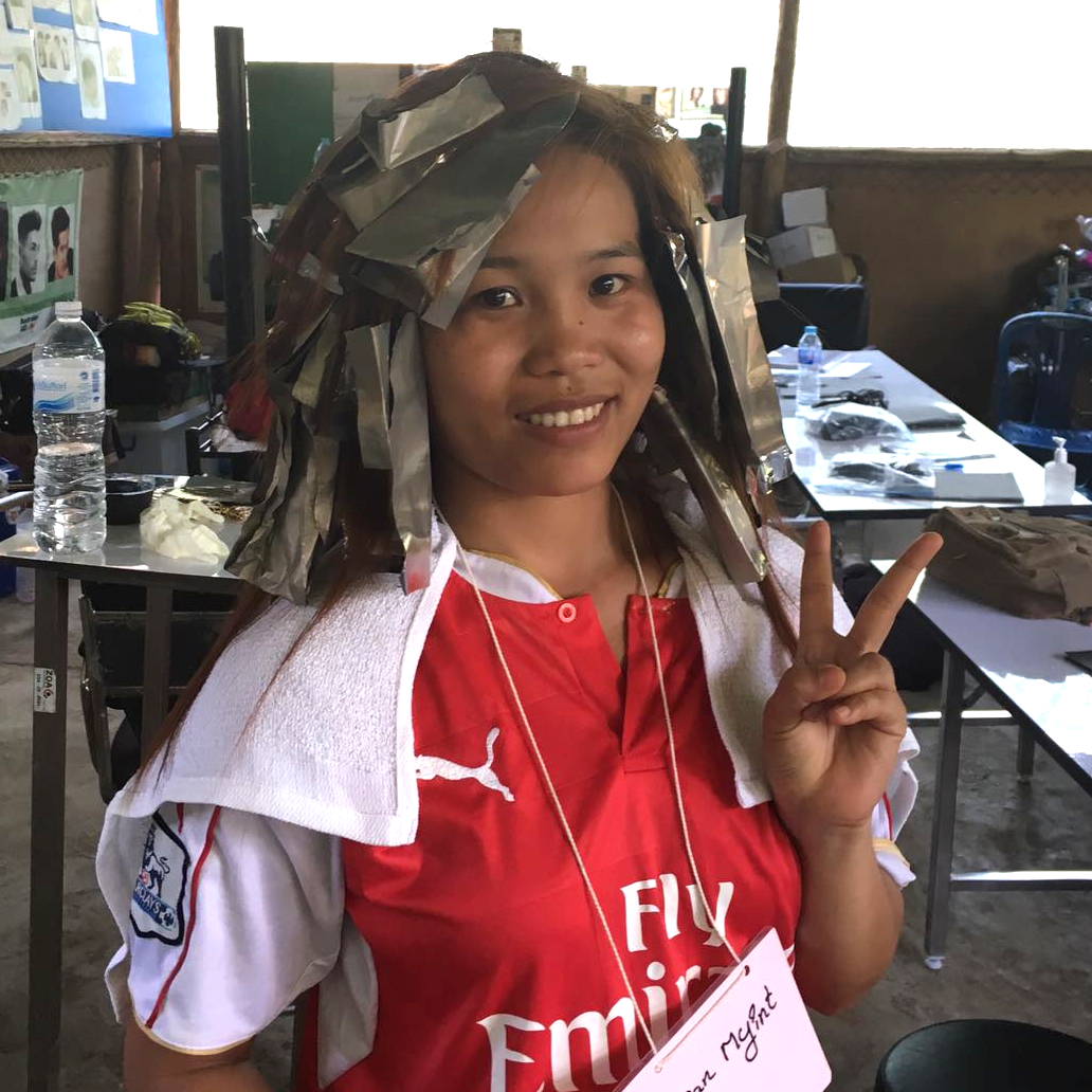 San San Myint sits in foils as her color processes. We can relate!