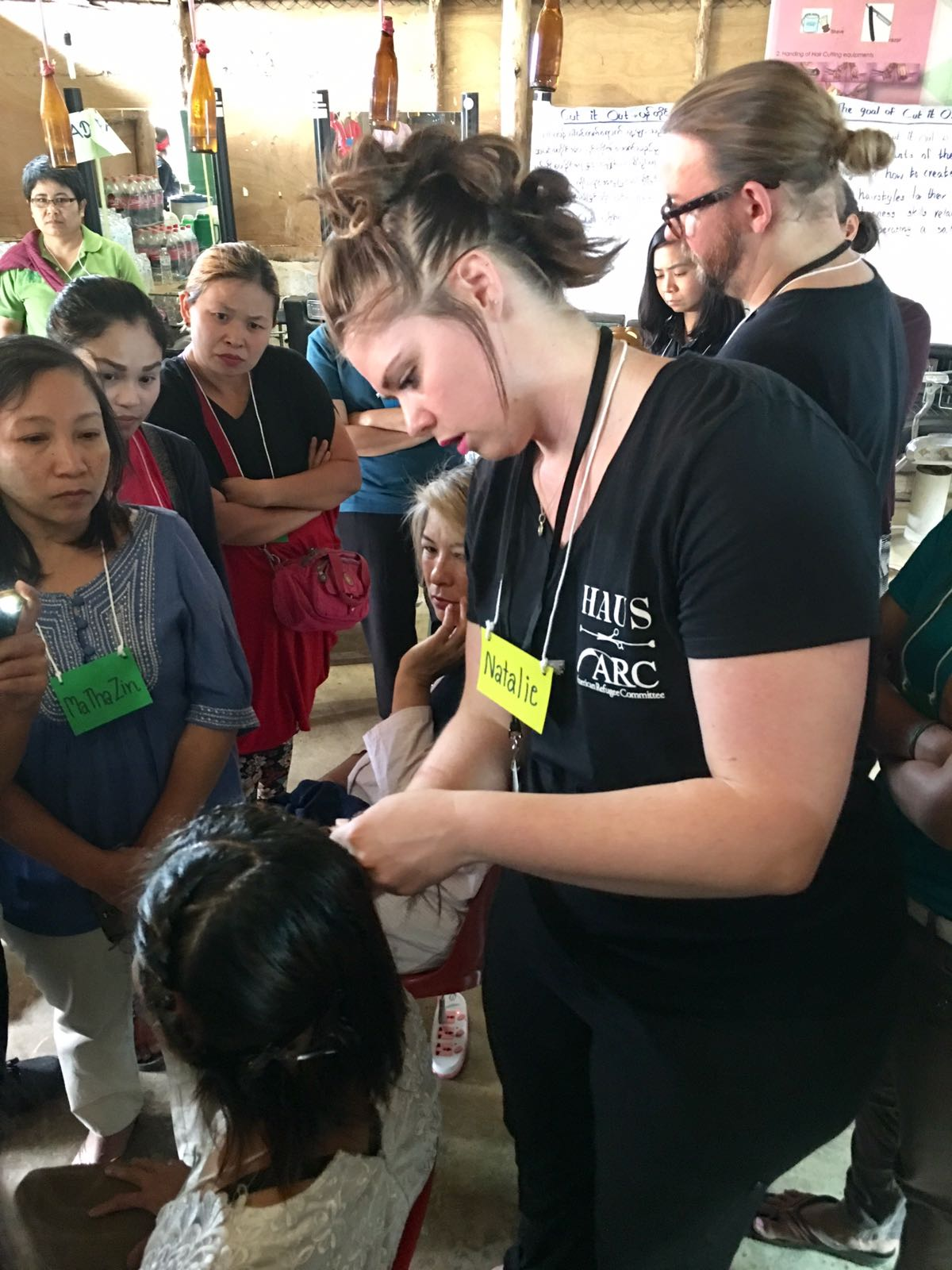Natalie Hansen from HAUS Salon demonstrates a flat 2 strand twist that will help stylists add curl to their clients' hair in this climate. This is a technique we ourselves just learned in Minneapolis from texture expert Reese!