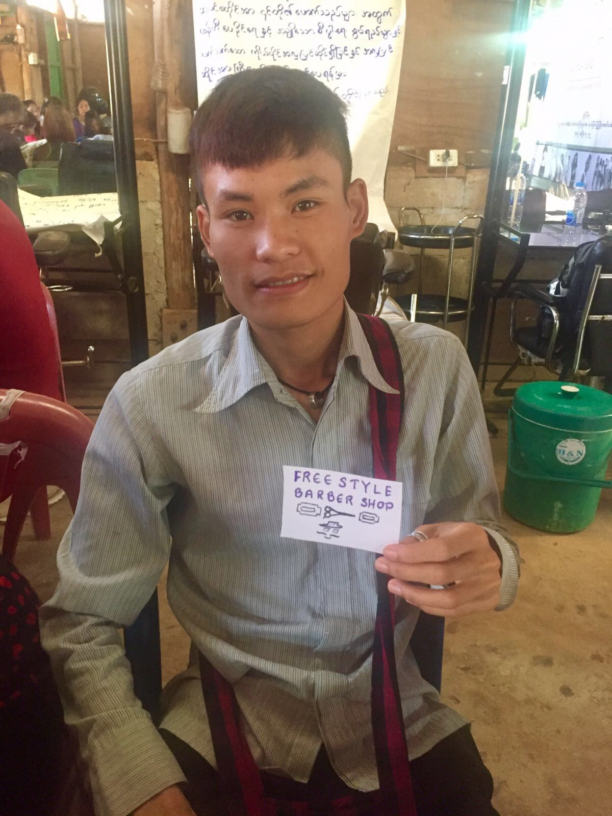 Freestyle Barber Shop owner with his new business card idea.