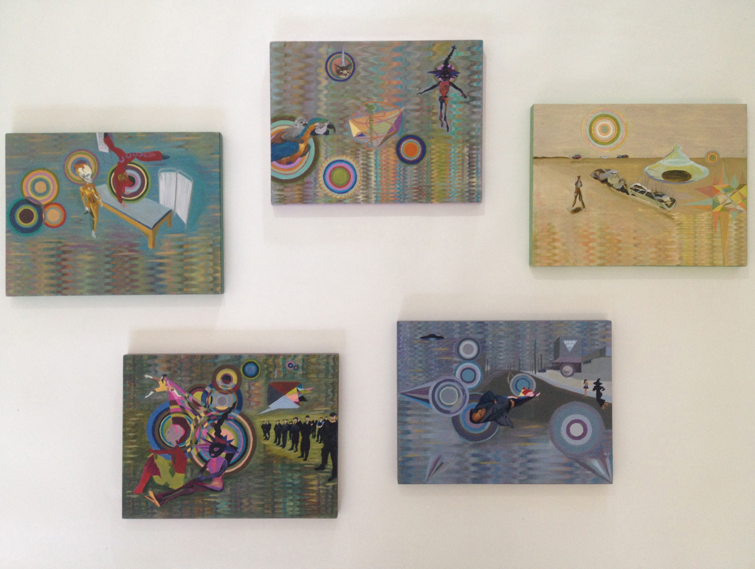 Jacquelene Drinkall,  Weaving My Avatars,  oil on cowrie pine, each 25 cm (height) x 27 cm (length) installed in a cluster 85 cm (height) x 95 cm (length) at Grace Cossington Smith Gallery, 2013. These paintings combine images from virtual world performance, documentation of Occupy Sydney activists, imagery sourced from social media, and other artworks by the artist Jacquelene Drinkall.