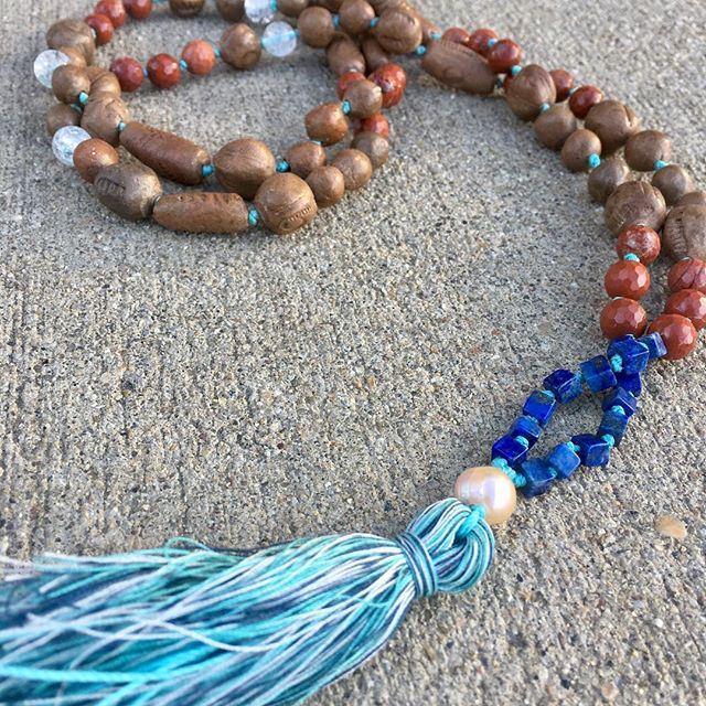 The story of this Mala is that an old mentor gave me a gift of a clay necklace with an old man chieftain face as a pendant. To protect me. It broke some years later and I saved the beads. And years after that, I was guided to make her a Mala using the stones from her original gift.