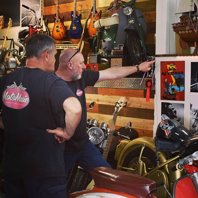 Julian and Dom are hard at work deciding where to hang the new framed t-shirt.  #motomusic #cardiffbusiness #cardiff #motorcycle #guitar