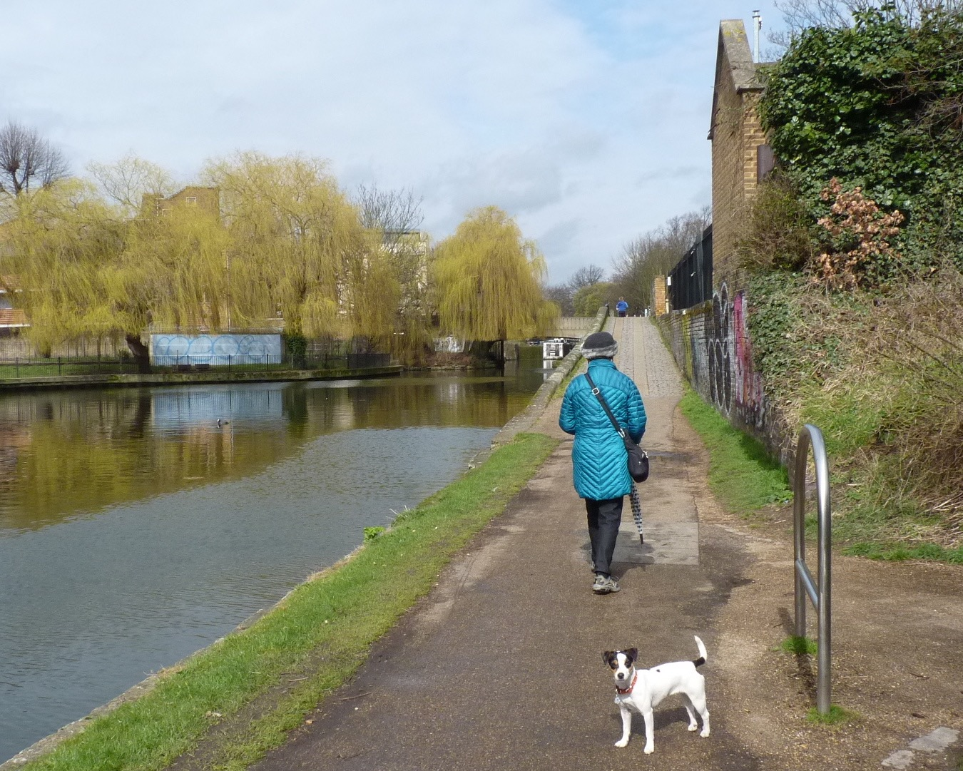 Here is a picture of the canals I walk down every day. They even have boats that people live on!