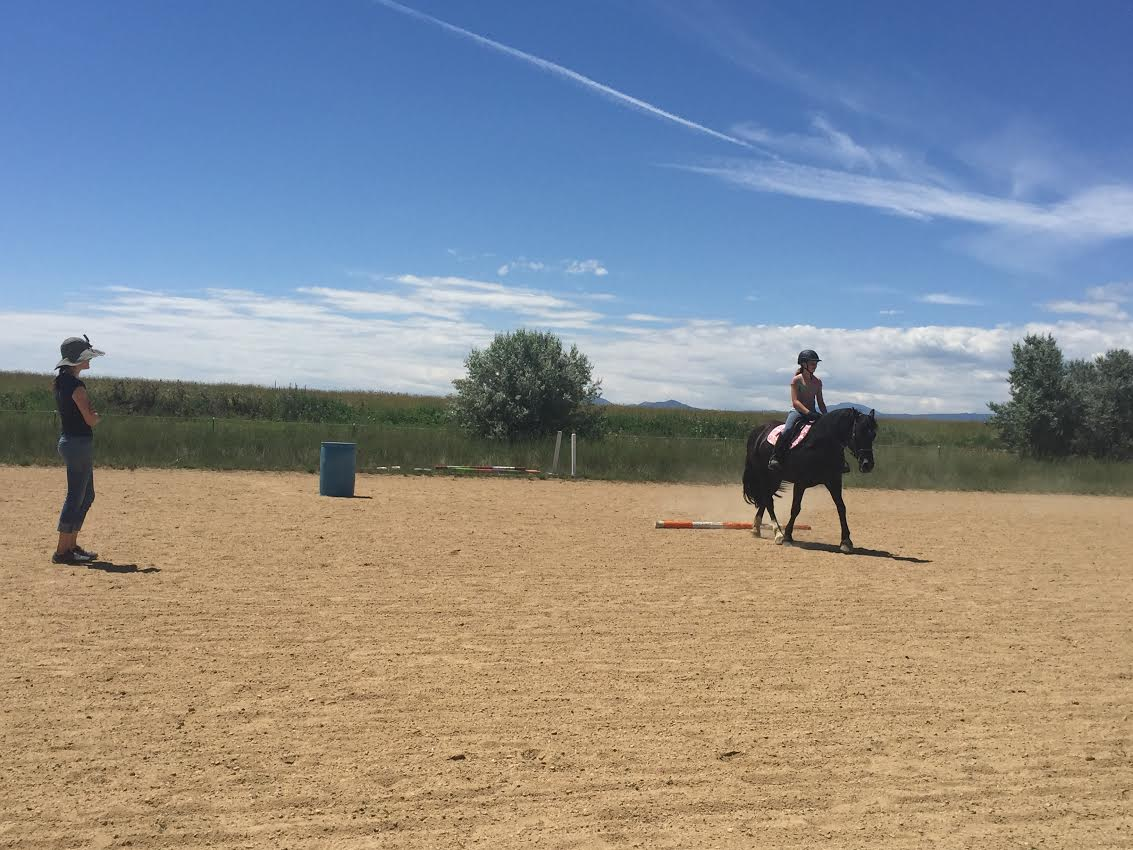 Cathy Lauderbaugh teaches horseback riding lessons in Boulder County, Colorado.