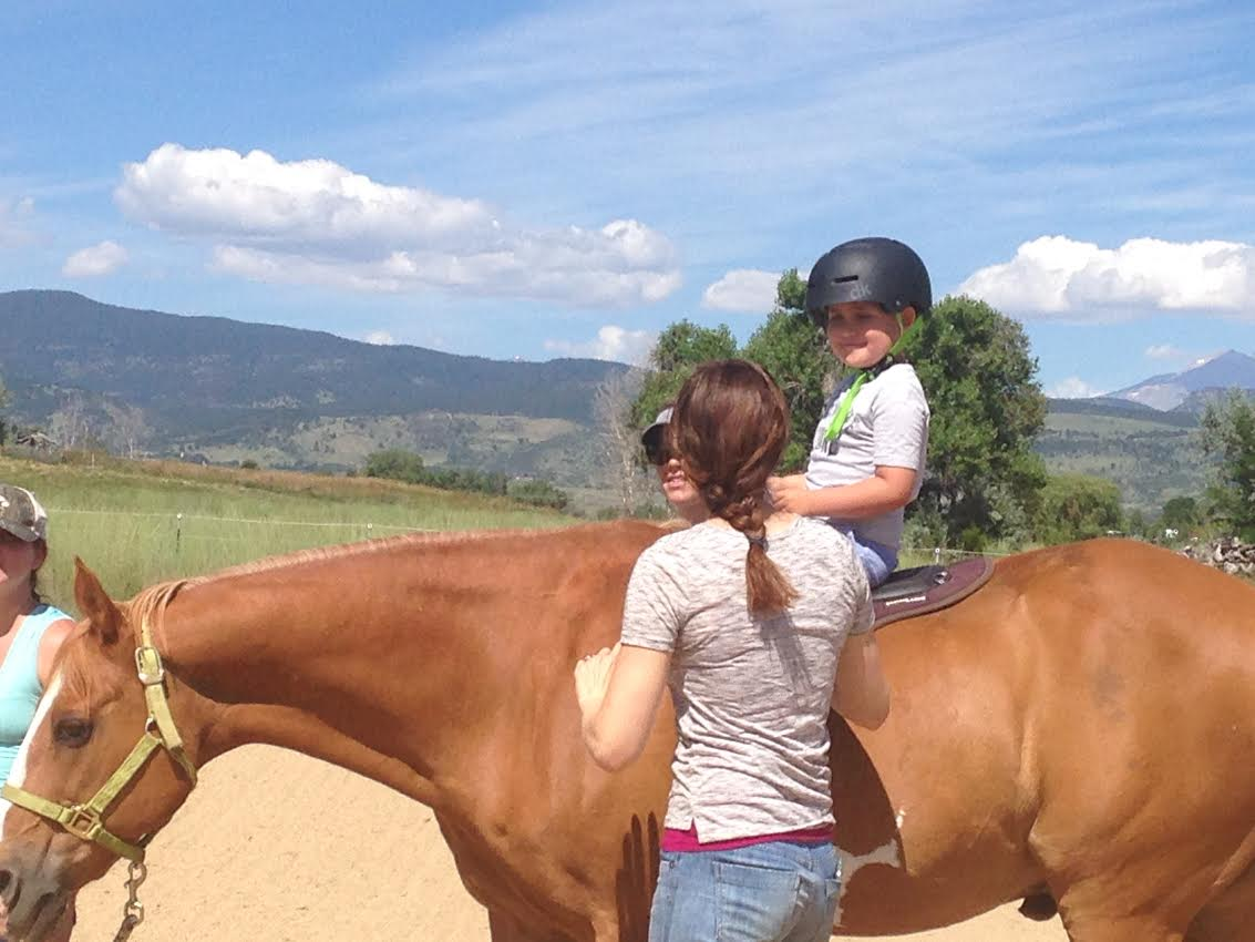 Cathy Lauderbaugh offers hippotherapy to support pediatric speech and language therapy goals, in Boulder County, Colorado.