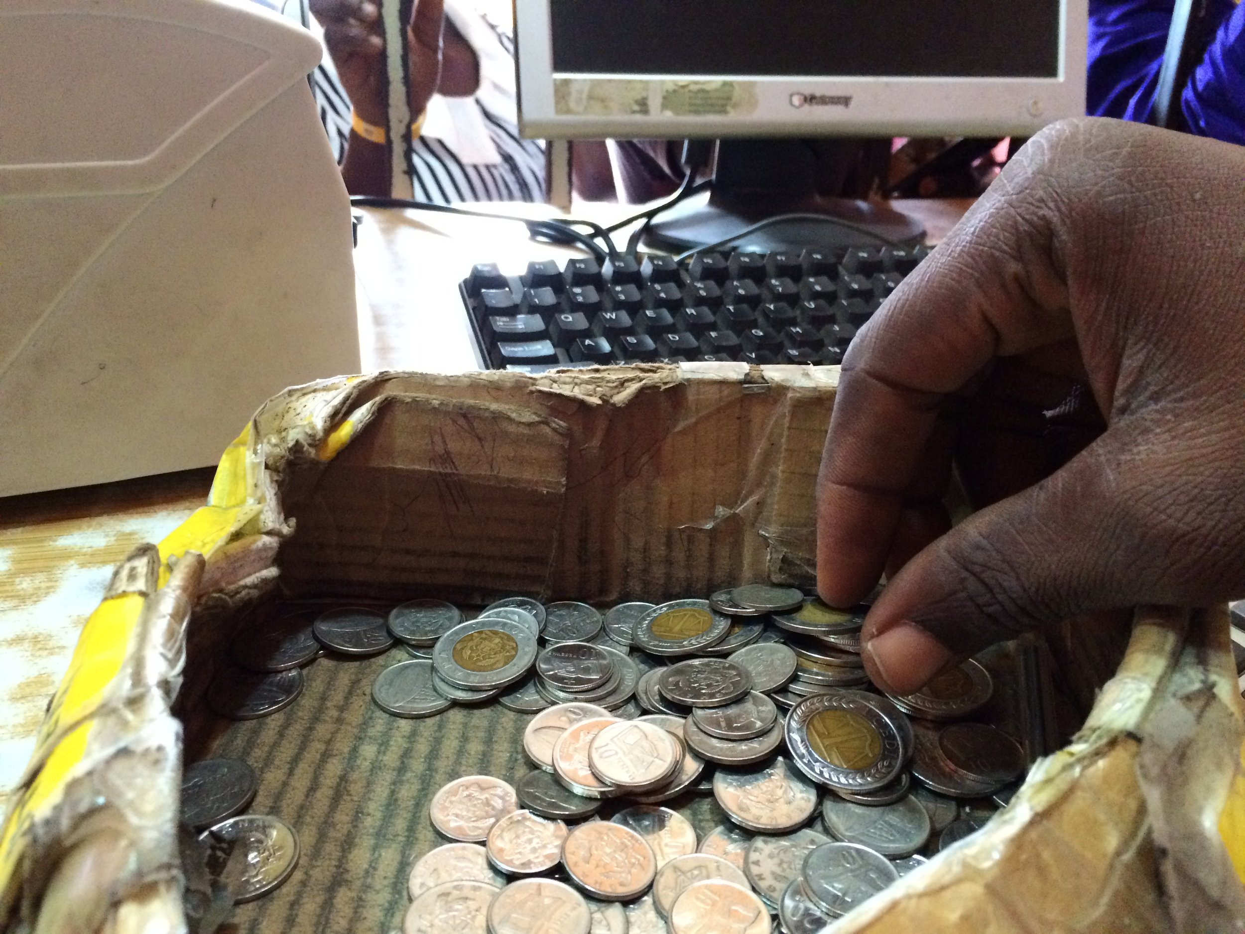 Counting Coins at Front.JPG