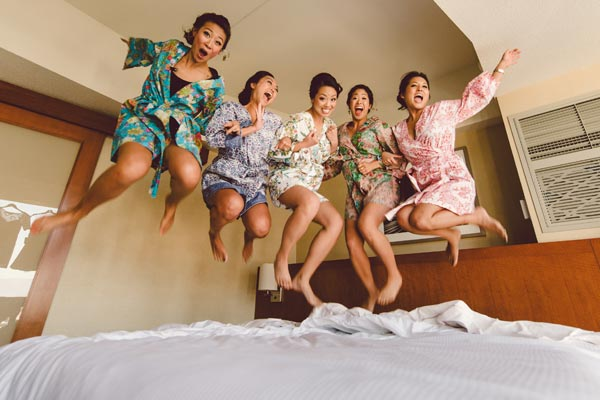 Do a throw back to your slumber party days with this carefree, jumping on the bed shot