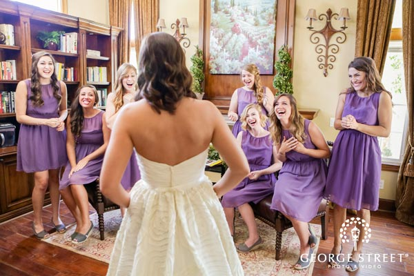 You will want to capture your girls' expressions the first time they see you on your wedding day. Be sure to get a 'reveal shot' with them
