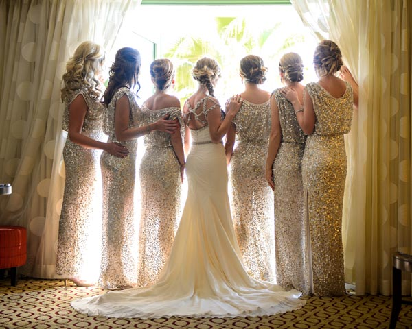 Don't forget to capture all of you from the back to showcase the back of the gowns. We love this shot which is silhouetted by the window