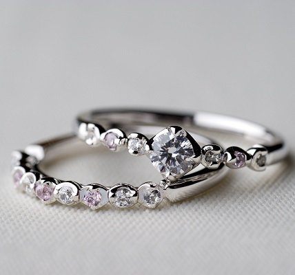 During the ceremony, you'll want to leave your ring finger on your left hand free so your groom can slip on your wedding band. You can simply move your engagement ring to your right hand or have someone hold it for you until after your vows, when you can slip it back on for the reception. Remember: The band is usually worn closest to your heart on your left hand.