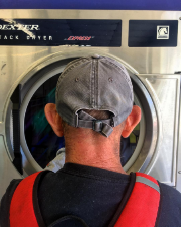 """Dad meets laundromat."""