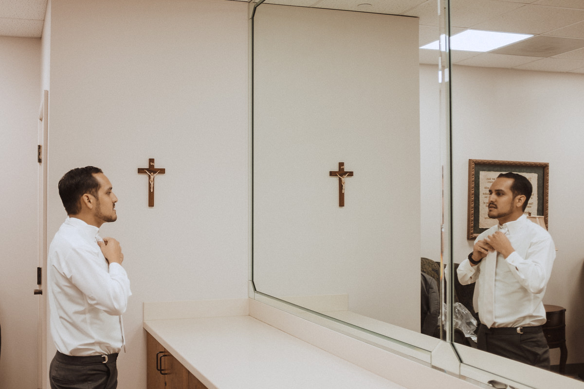 houston wedding groom in mirror