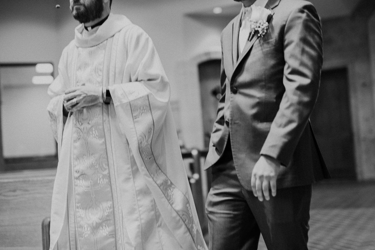 Groom and Priest at wedding
