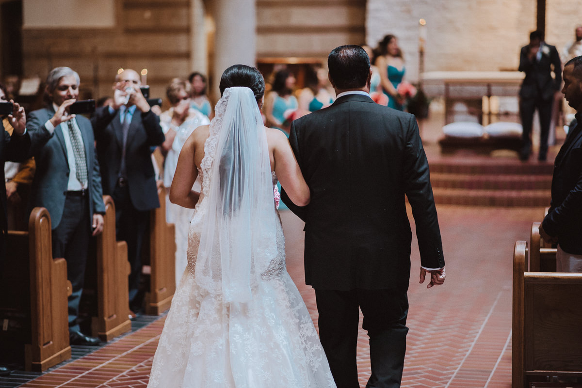 Bride and Dad walk to alter