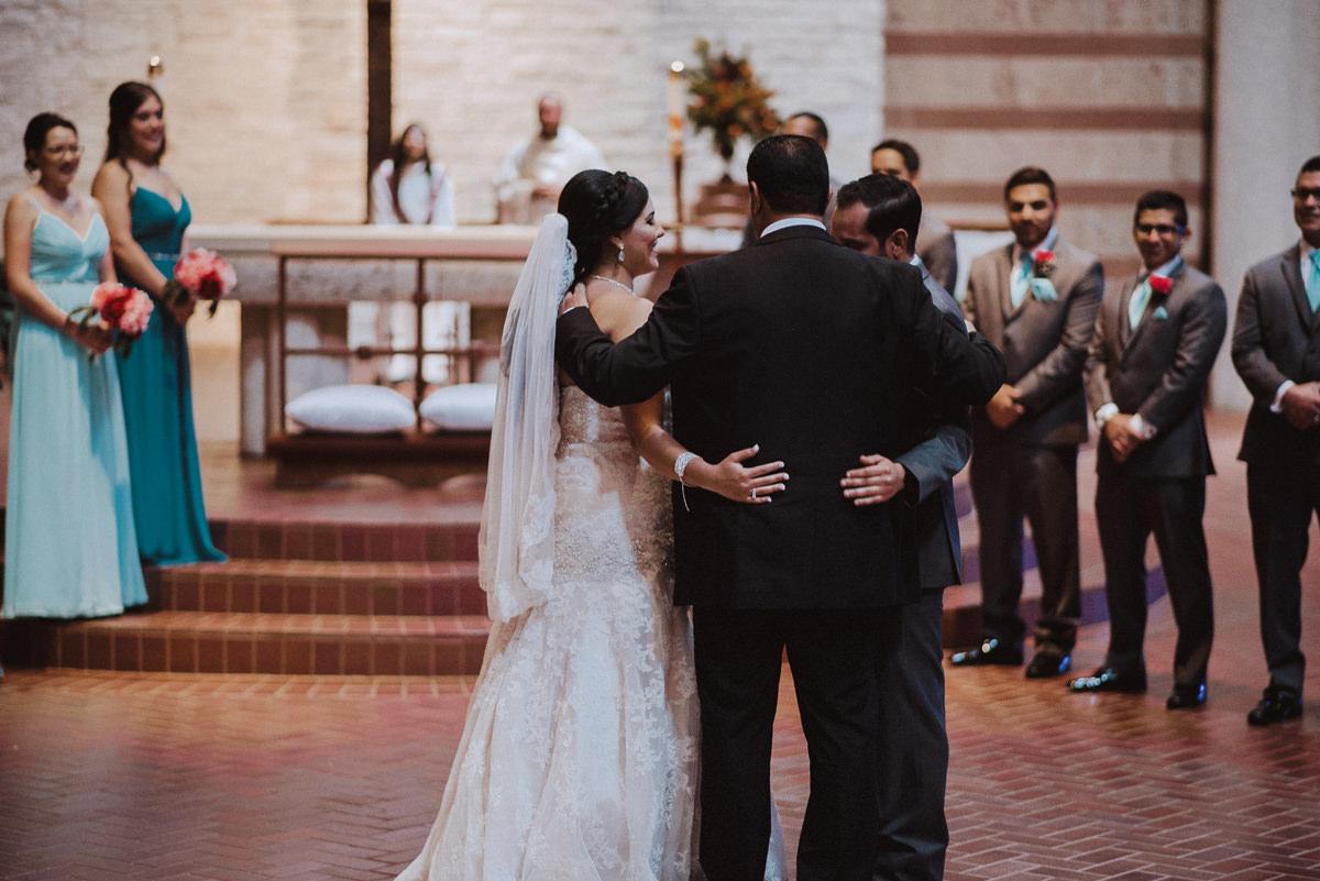 Bride groom and dad at altar