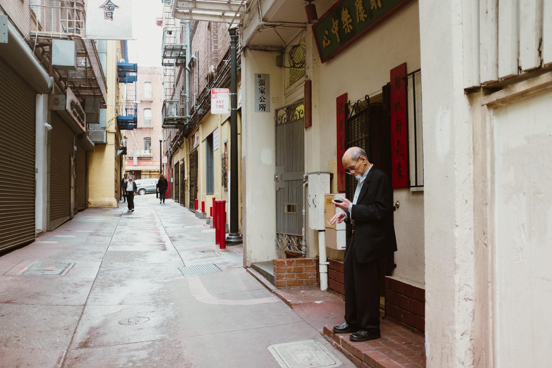Man Smoking in Chinatown Alley