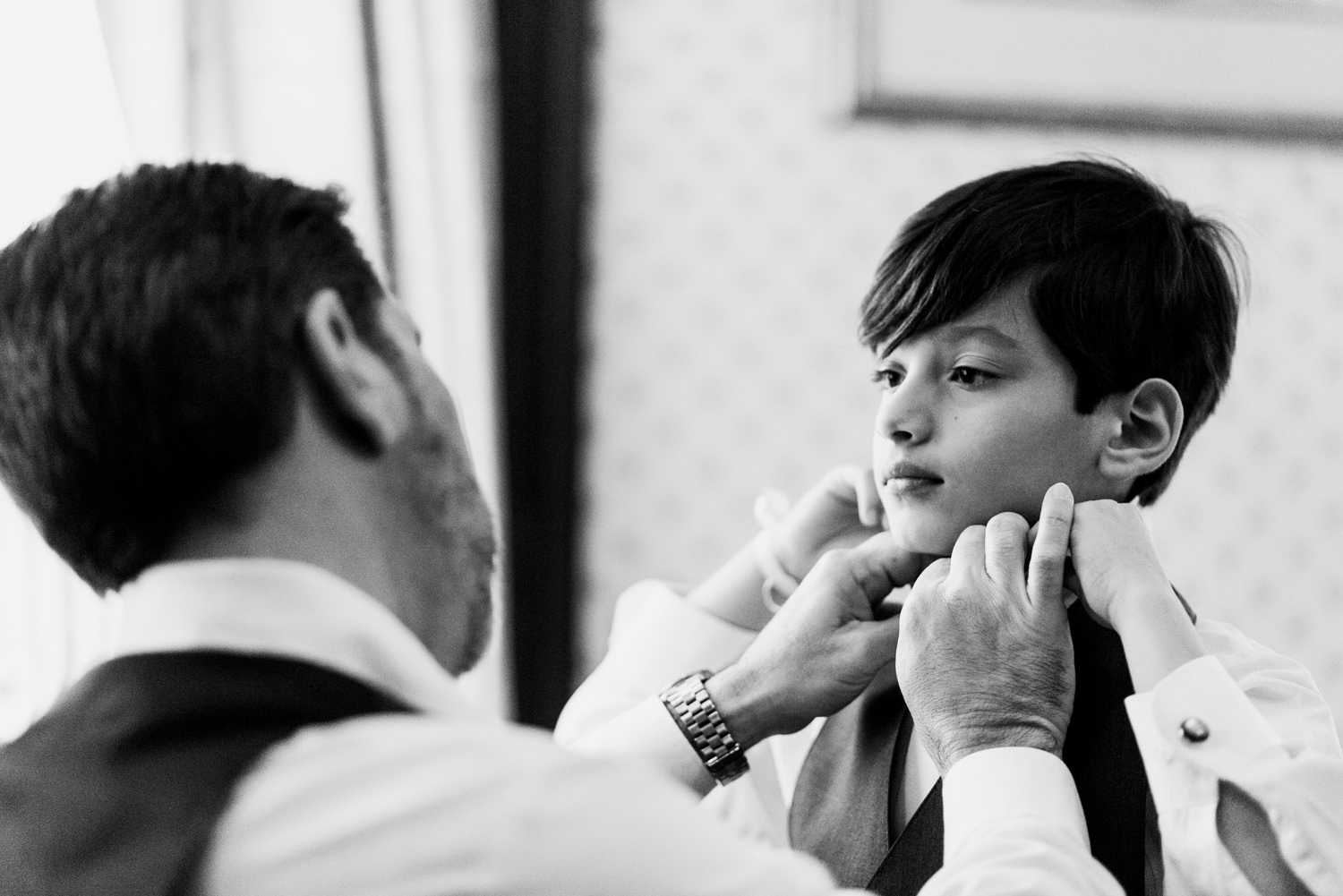groom and son getting ready at austin wedding