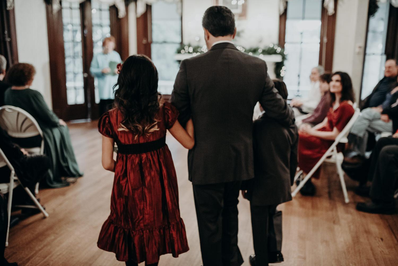 groom walking down the aisle at wedding