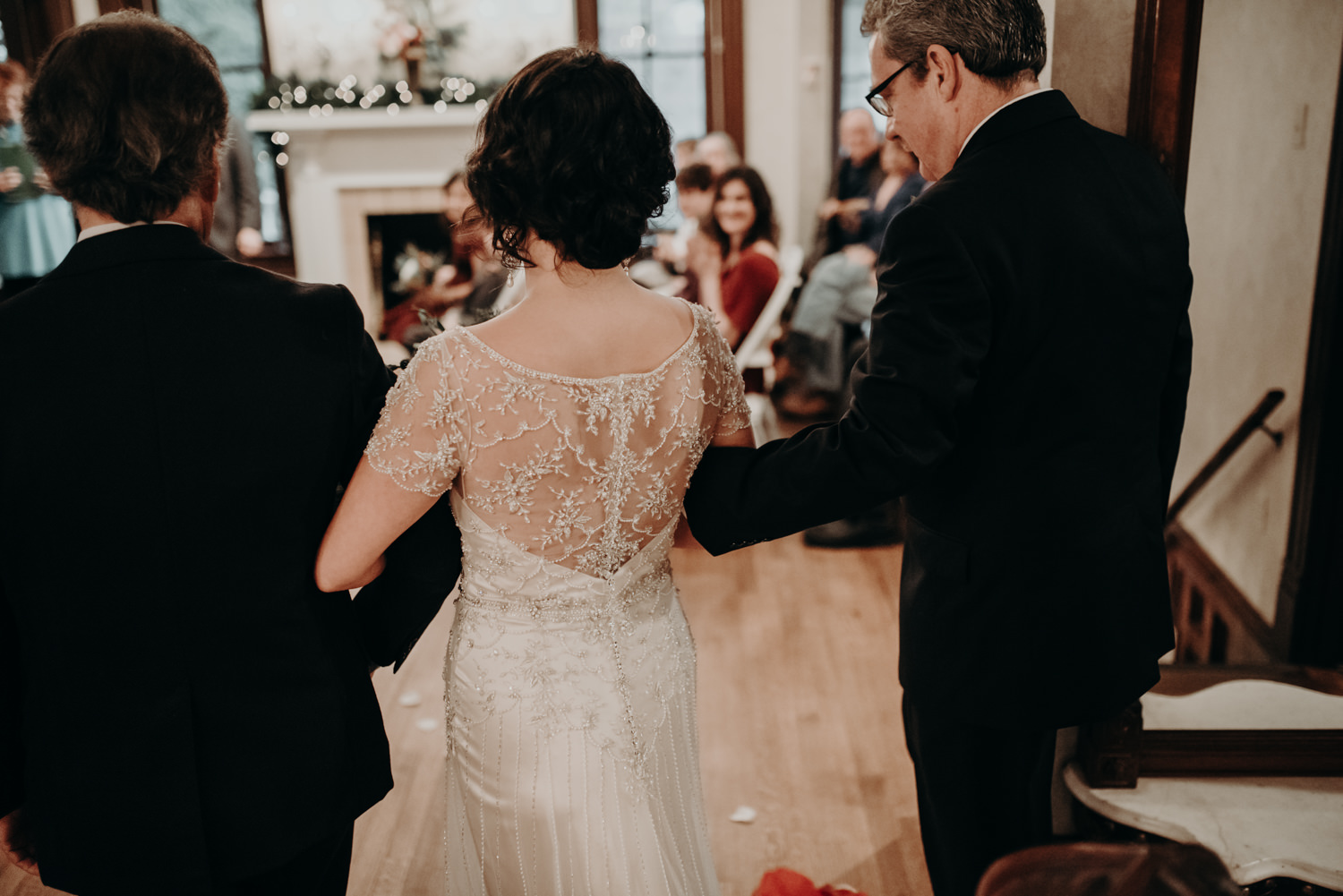 bride walked down the aisle by father and stepfather