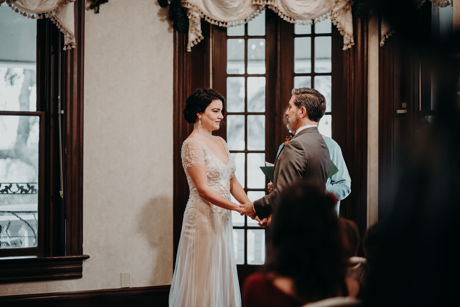 bride and groom get married in victorian home