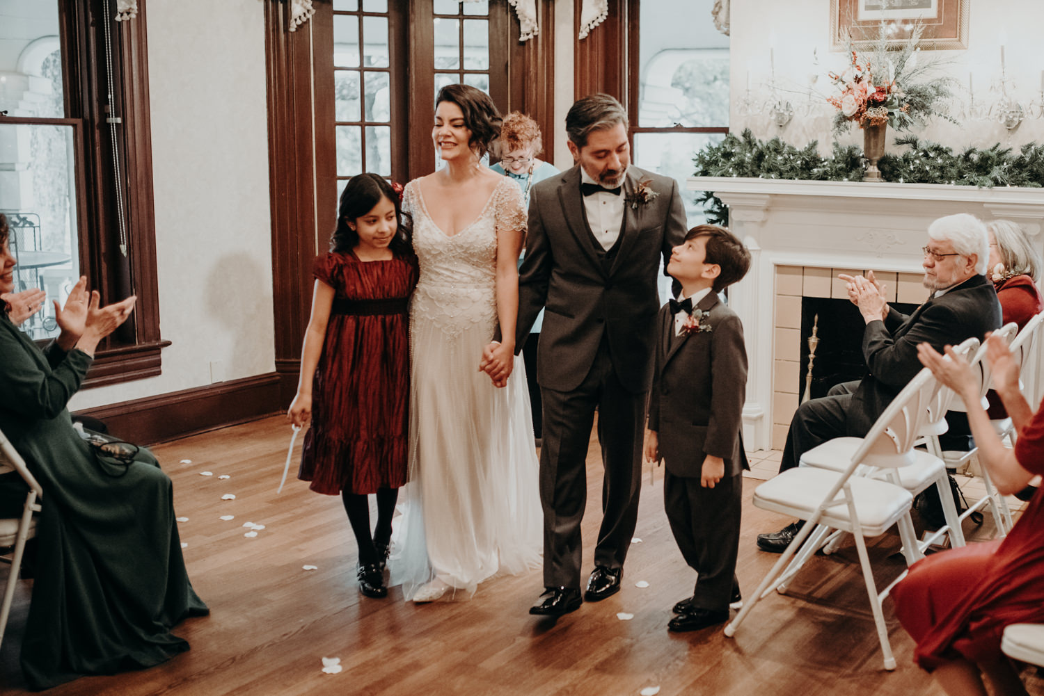 family walks down the aisle after wedding