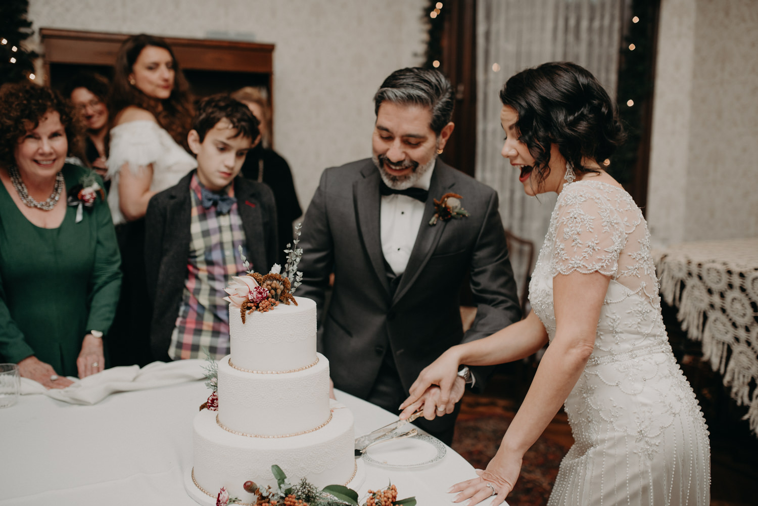 cutting the wedding cake at reception