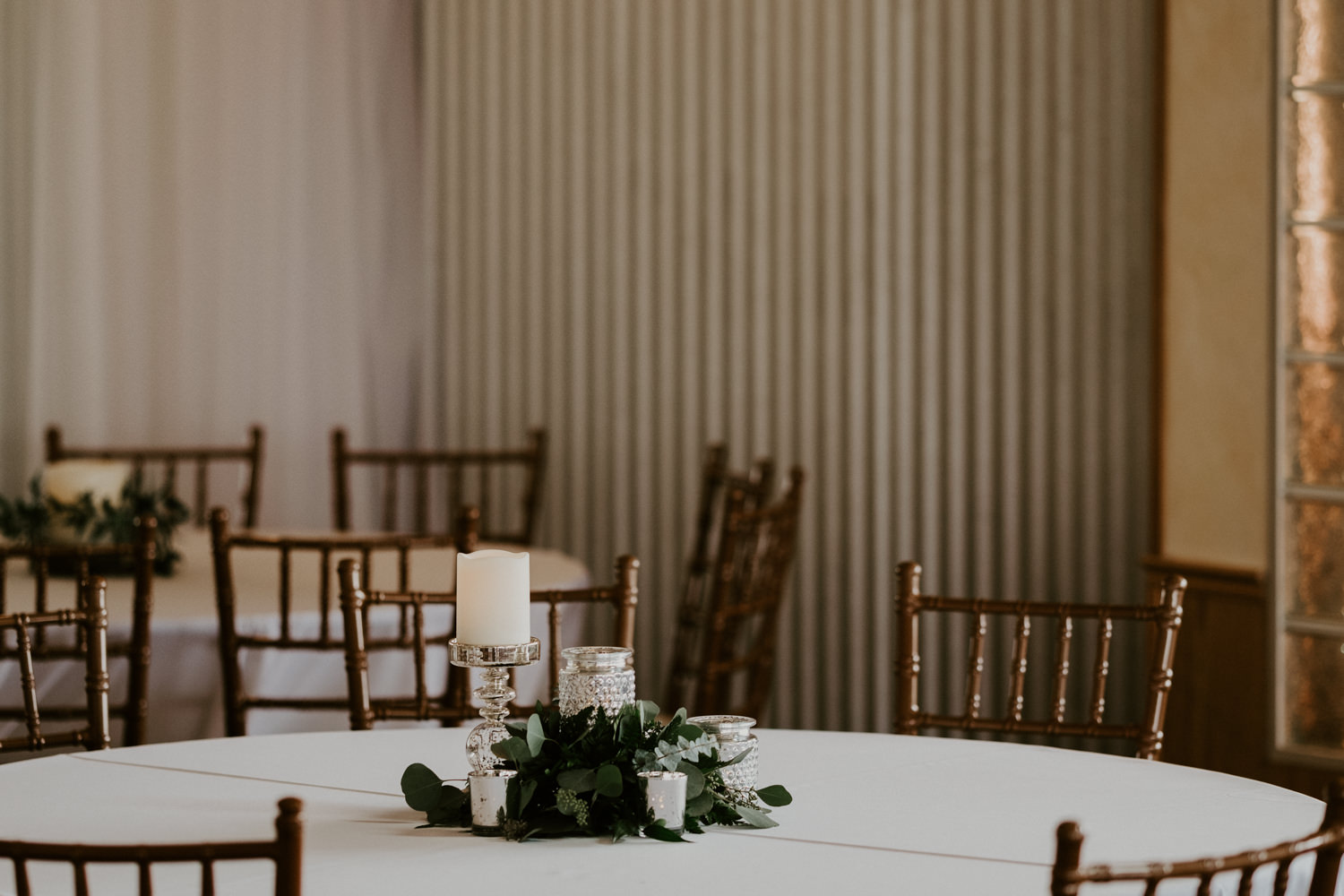 candles and greenery wedding centerpiece