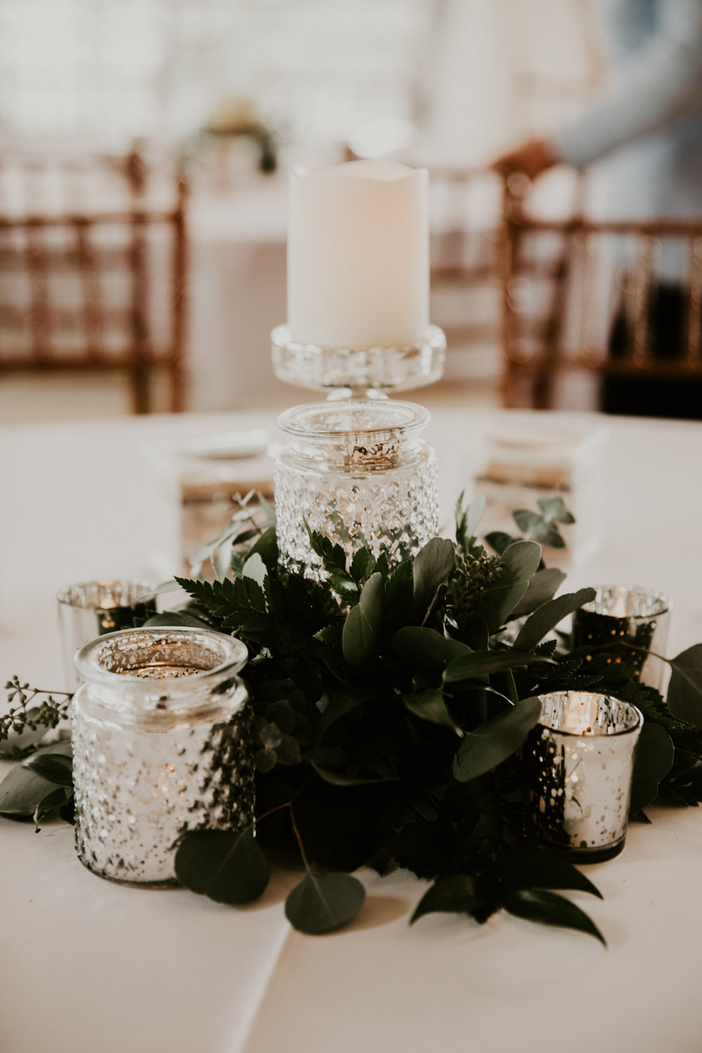 Candles and greenery modern wedding centerpiece