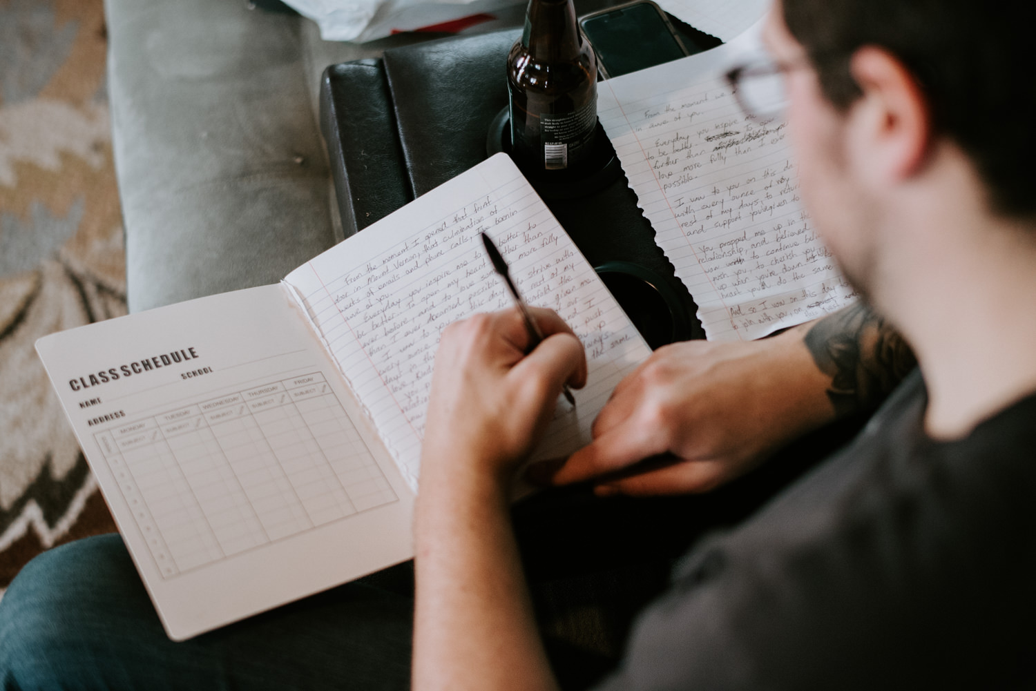 Groom writing vows before wedding ceremony