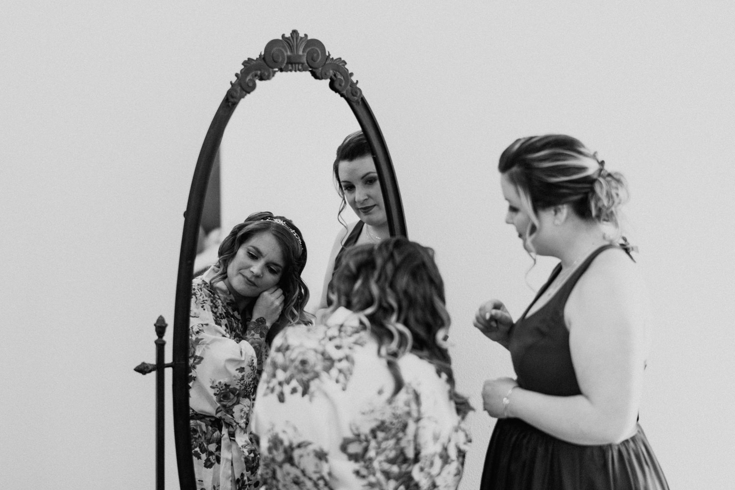 maid of honor and bride getting ready at wedding
