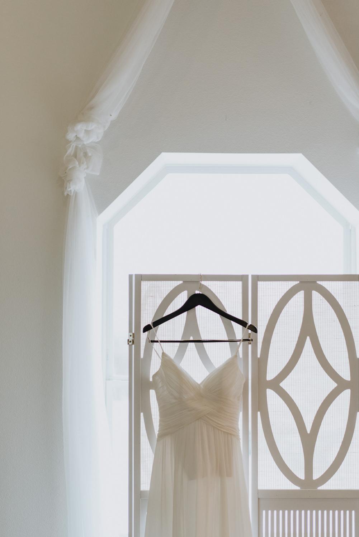 wedding dress hanging in bridal suite at TerrAdorna