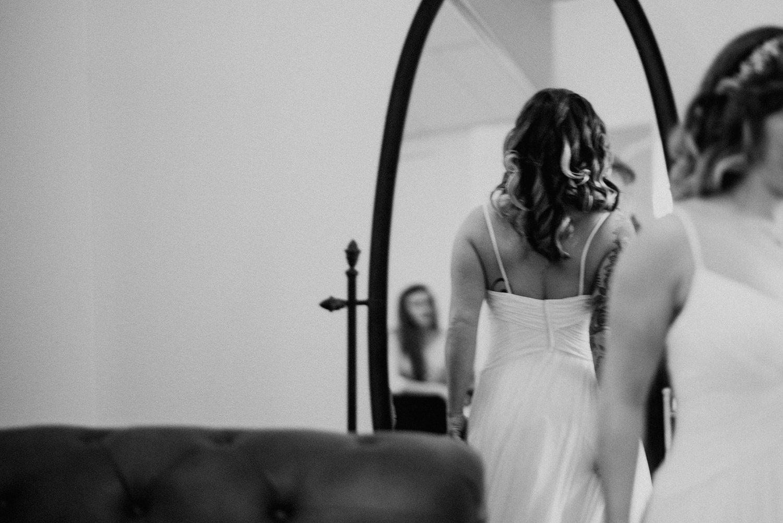 bride in mirror at texas wedding