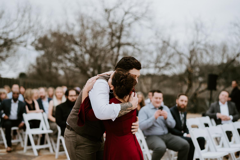Groom hugs his mother before wedding at TerrAdorna