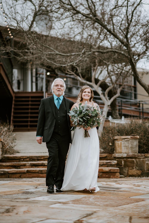 Bride walks down the aisle at TerrAdorna wedding