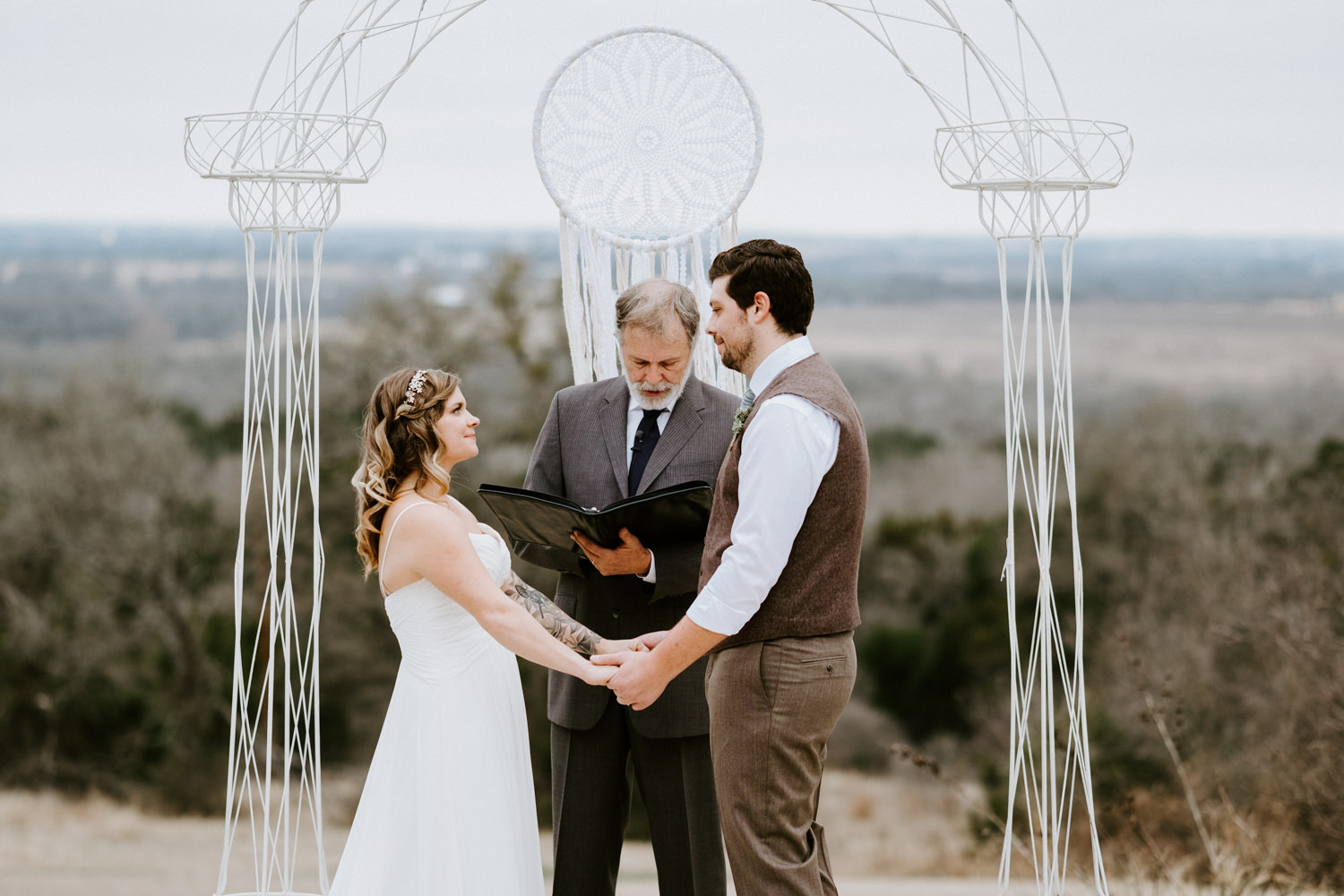 Bride and groom holding hands at austin texas wedding