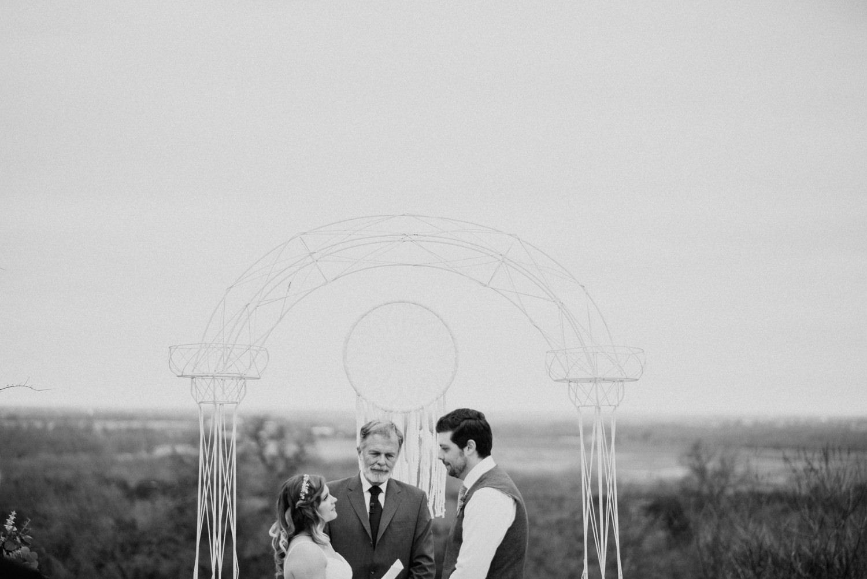wedding ceremony overlooking texas farm
