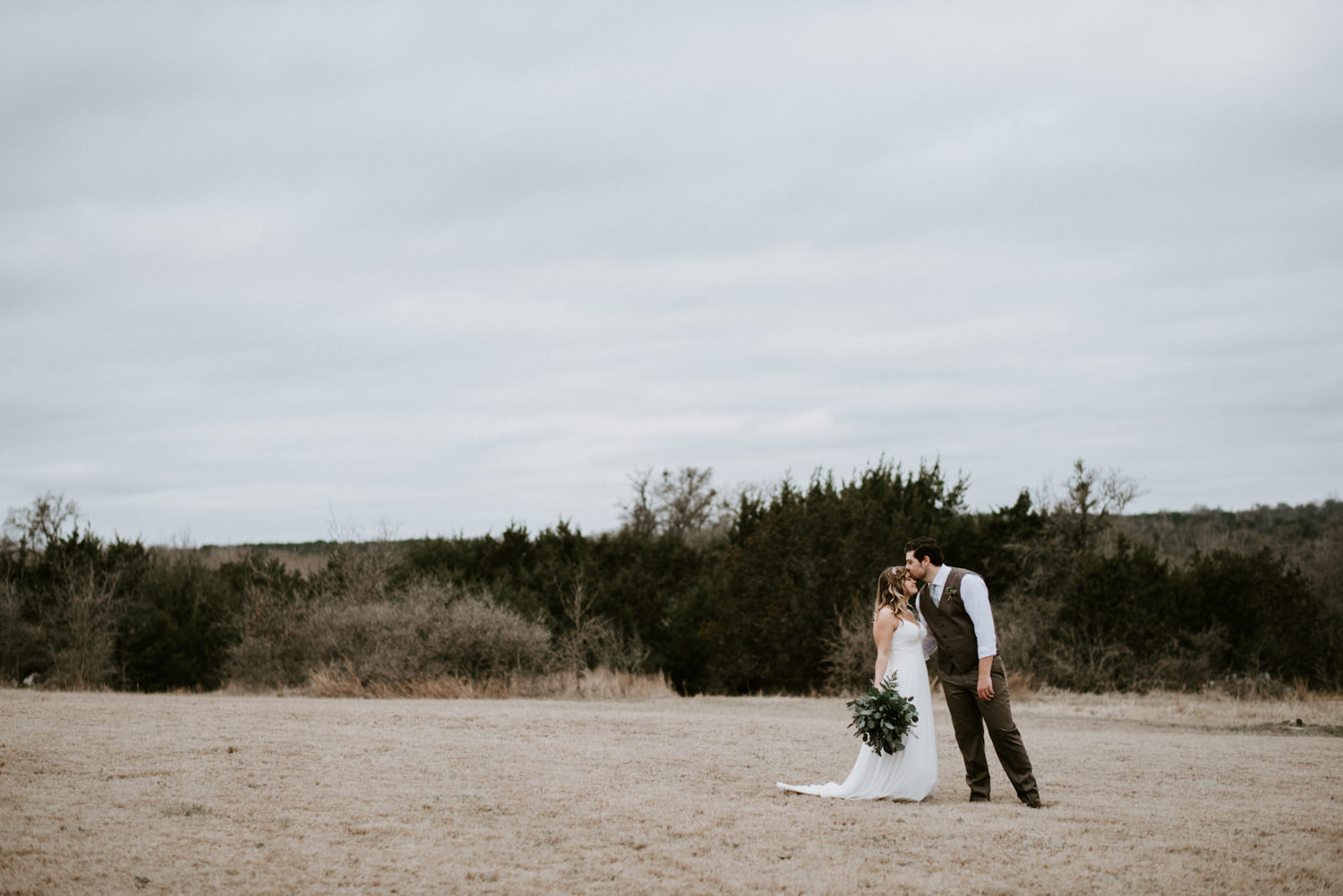 bride and groom portraits in an open field