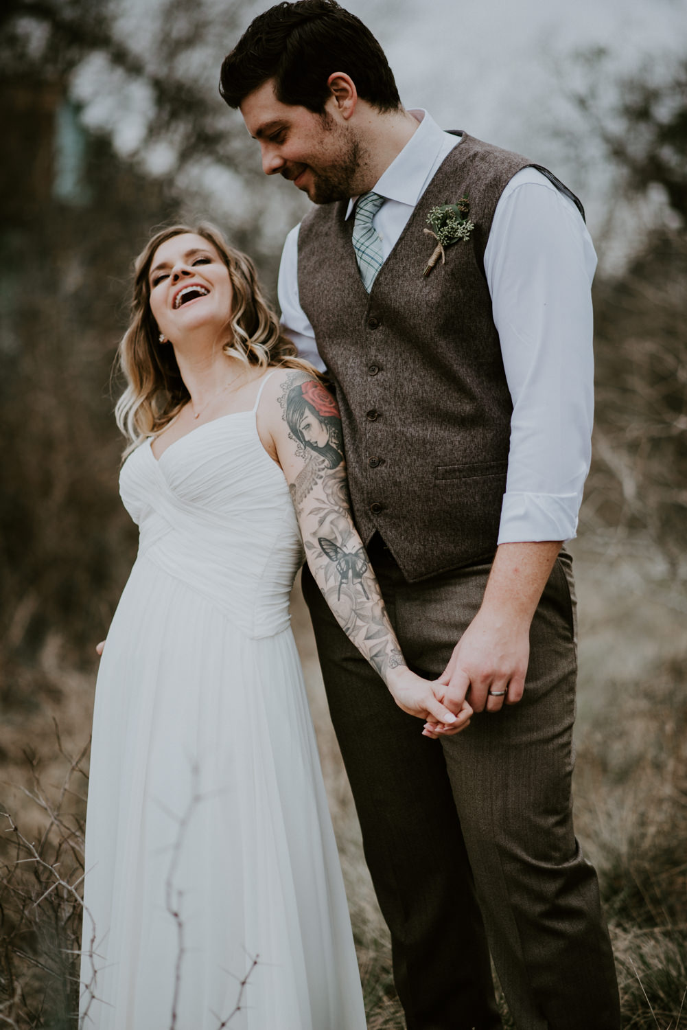 bride and groom laugh during portraits at austin wedding