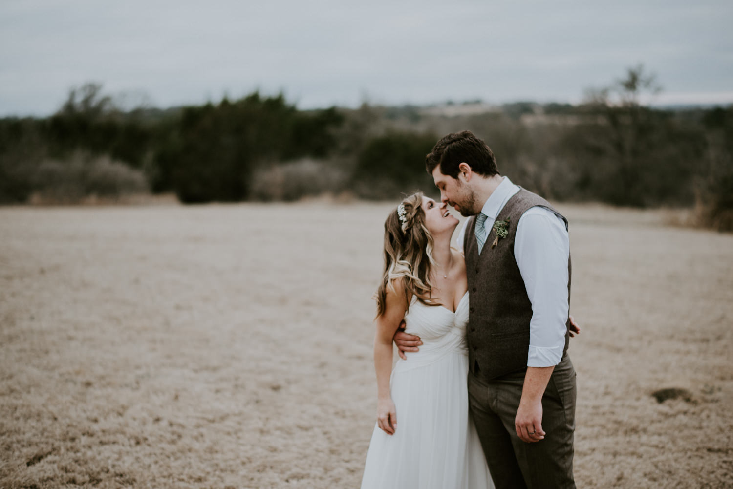 laughing bride and groom during portraits