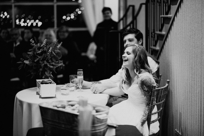wedding couple react to funny speech